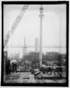 Carpenters and riggers working on a vessel at the Virginia Shipbuilding Corporation.