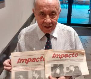 [Figure 2 – Julio Duran holding a copy of Impacto in which he interviewed George H. W. Bush – image courtesy of El Tiempo Latino -- http://eltiempolatino.com/news/2015/apr/20/veterano-periodista-retorna-su-patria-querida/]